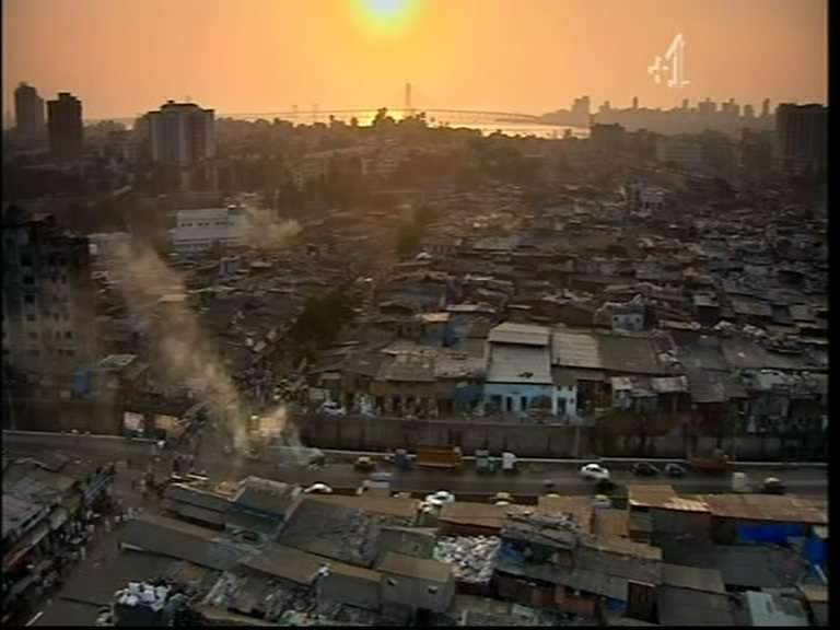 dharavi slum 2015-07-23  how taking a dharavi slum tour changed my perceptions on poverty as i stand on the bridge over the thundering railway, a maze of corrugated shacks, blue.